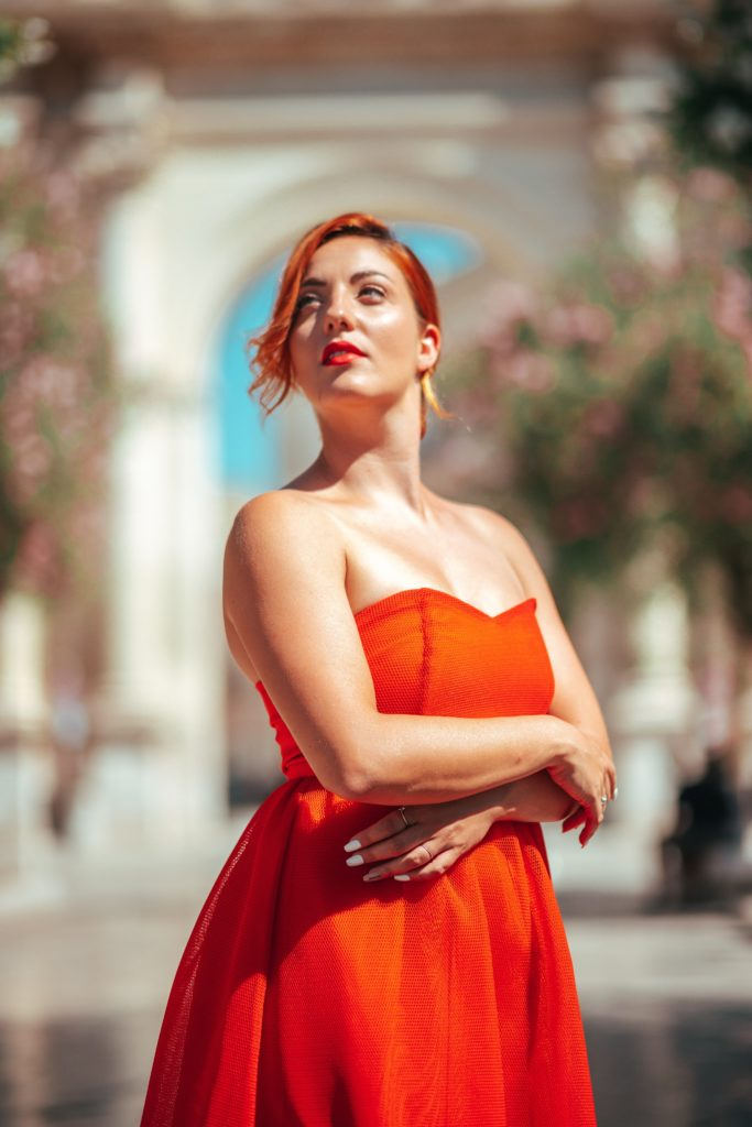 woman in red strapless dress